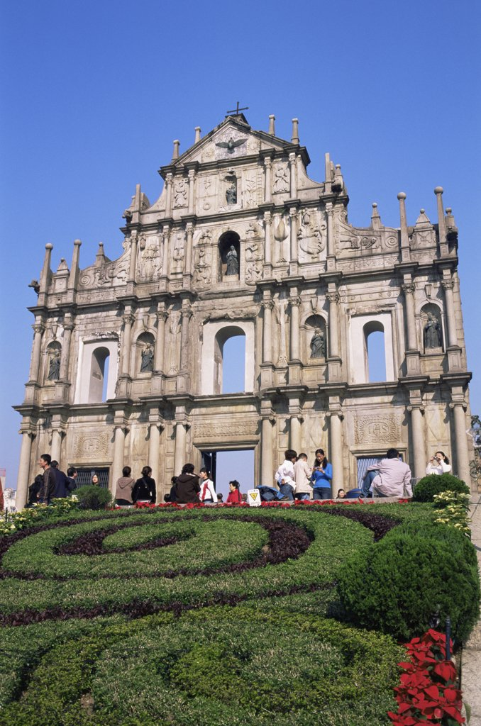 Tourists in front of a cathedral, St. Paul's Cathedral, Macao, China : Stock Photo