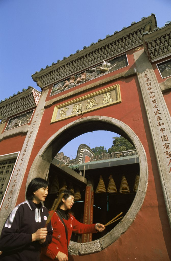 Young couple walking in front of a temple, A-Ma Temple, Barra Square, Macao, China : Stock Photo