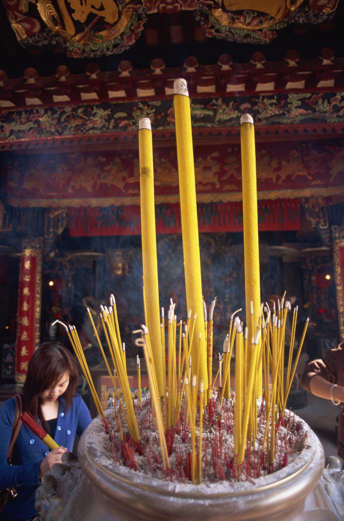 Close-up of incense sticks burning in a temple, Pak Tai Temple, Cheung Chau, Hong Kong, China : Stock Photo