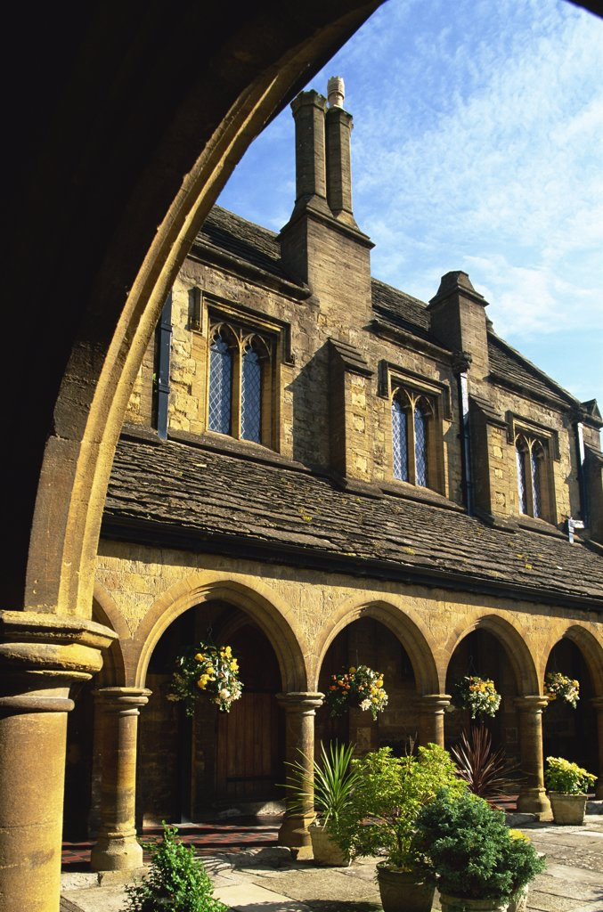 Stock Photo: 442-10498 Almshouse viewed from an arch, St. John's Almshouse, Sherborne, Somerset, Dorset, England