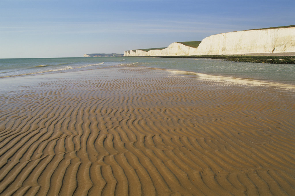 Stock Photo: 442-10599A Rippled pattern on sand with limestone cliff in the background, Seven Sisters, Beachy Head, Eastbourne, East Sussex, England