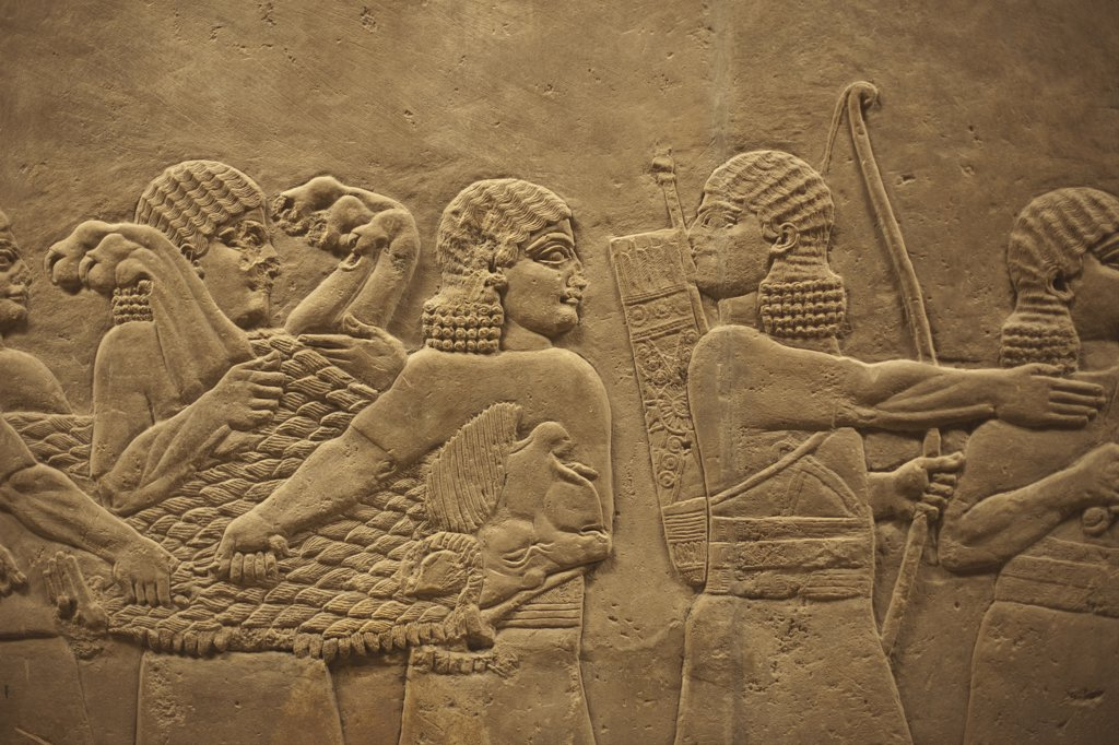 Relief from Nineveh Northern Iraq showing hunters with dead lion (645 BC), British Museum, London, England : Stock Photo