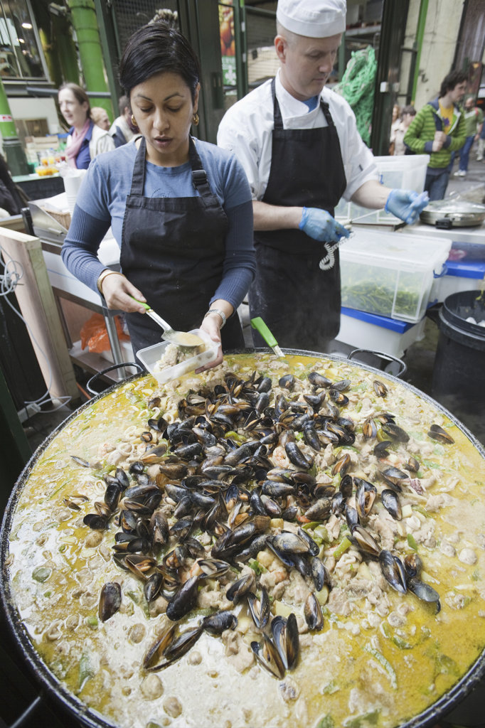 Stock Photo: 442-10835 England, London, Southwark, Borough Market, Chef Cooking Curried Mussels