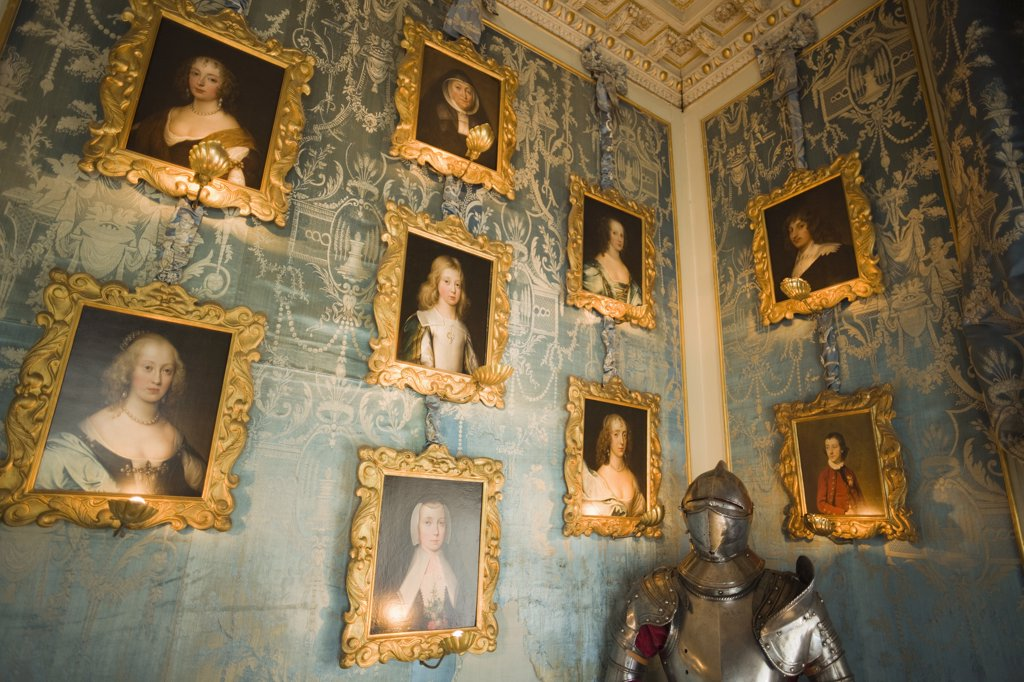 Stock Photo: 442-10916 Picture frames and a suit of armor a room, Blue Room, Warwick Castle, Warwick, Warwickshire, England