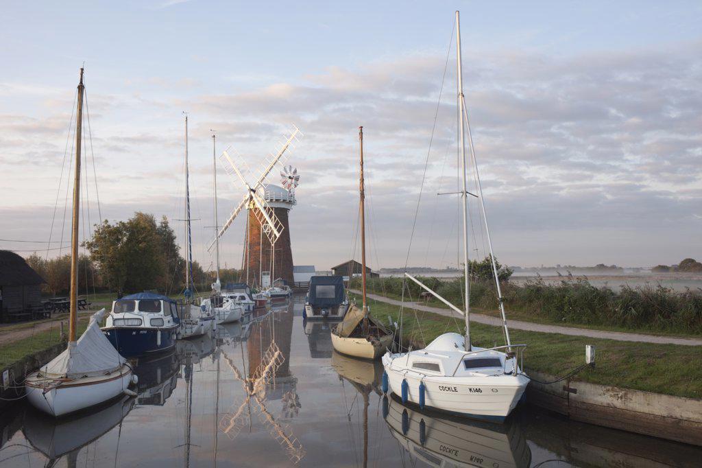 Drainage windmill at the riverside, Horsey Windpump, Horsey, Norfolk, East Anglia, England : Stock Photo