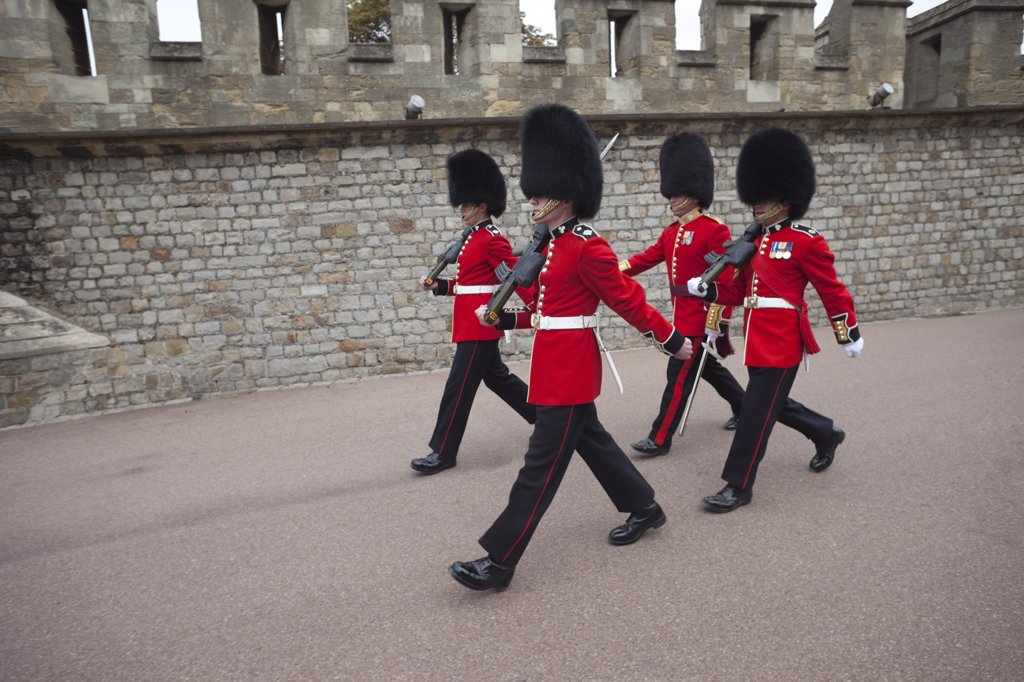 Royal guards marching at a castle, Windsor Castle, Windsor and Eton, Berkshire, England : Stock Photo