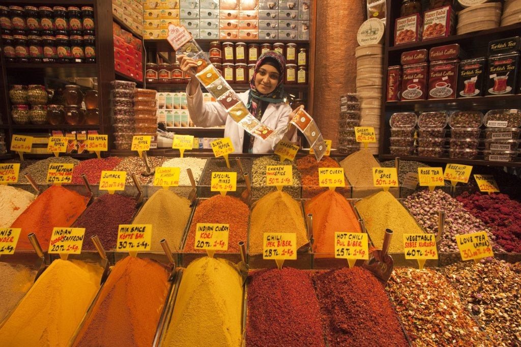 Stock Photo: 442-11403 Young woman selling spices, Sultanahmet, Istanbul, Turkey