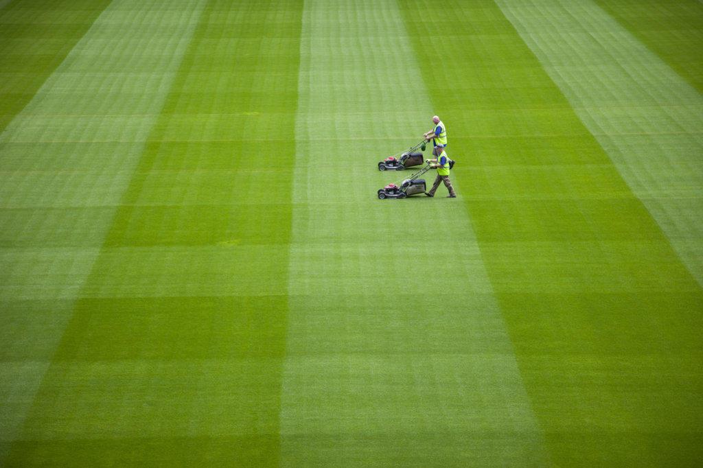 Stock Photo: 442-11445 Ireland, Dublin, Greenkeeper Mowing Playing Field in The Aviva Stadium