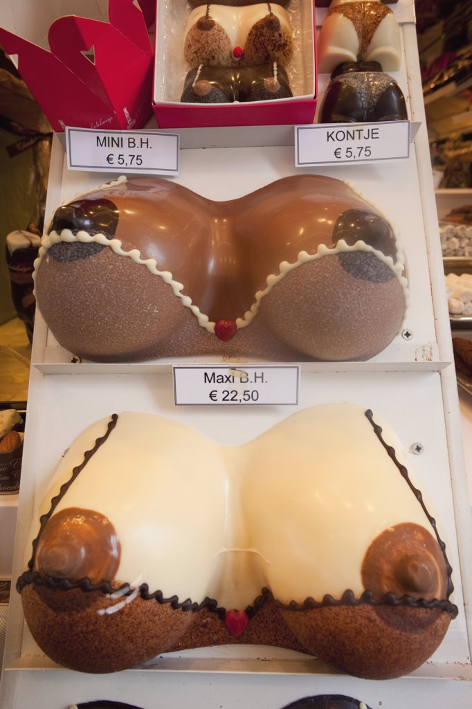Stock Photo: 442-11755 Belgium, Brussels, Chocolate shop window display, close up of breast shape chocolates