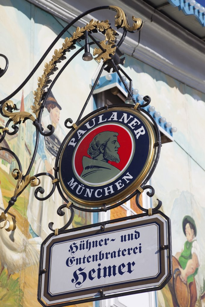 Low angle view of pub signs, Munich, Bavaria, Germany : Stock Photo