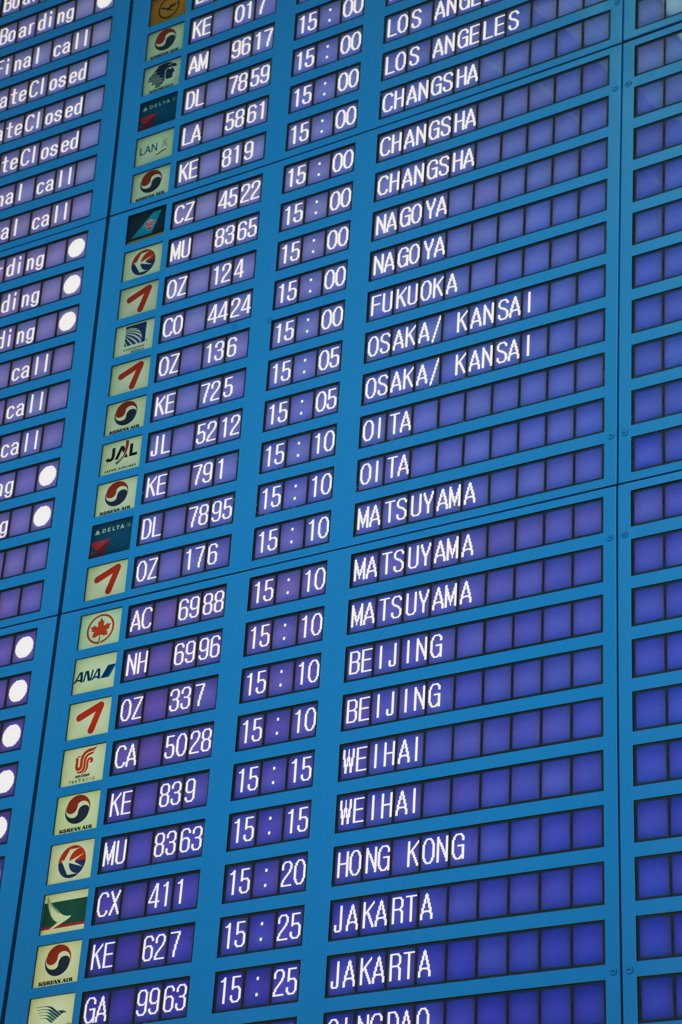 Arrival departure board at an airport, Incheon International Airport, Seoul, South Korea : Stock Photo