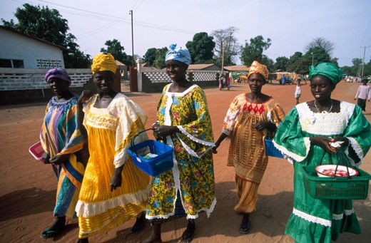 Group of mid adult women walking together on a street, Banjul, Gambia : Stock Photo