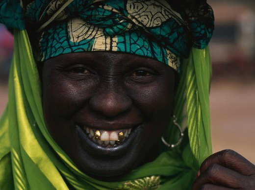 Portrait of a mid adult woman smiling, Banjul, Gambia : Stock Photo