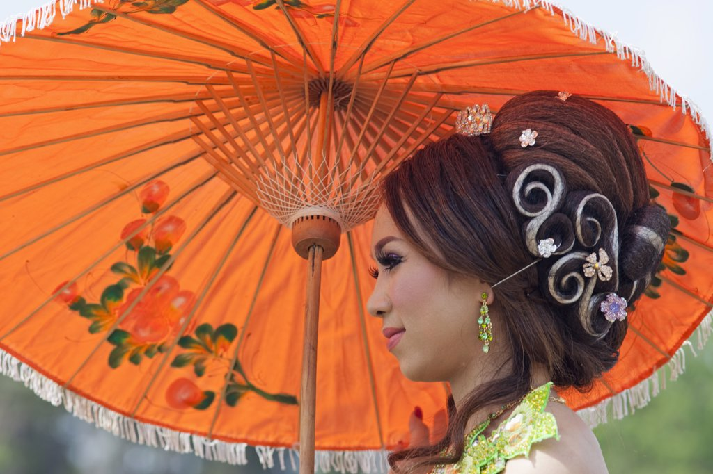 Close-up of a Cambodian bride holding an umbrella, Angkor Wat, Siem Reap, Cambodia : Stock Photo