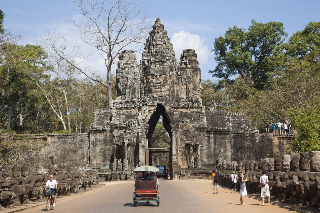 Stock Photo: 442-35389 Tourists at the South gate of a temple, Angkor Thom, Angkor, Siem Reap, Cambodia