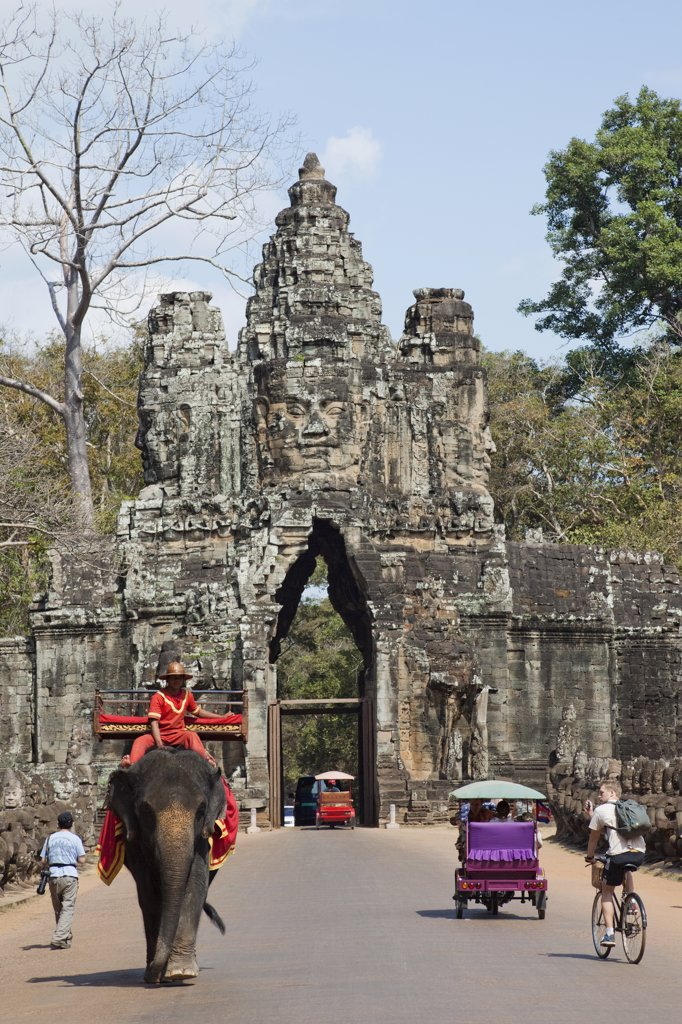 Stock Photo: 442-35390 Tourists at the South gate of a temple, Angkor Thom, Angkor, Siem Reap, Cambodia