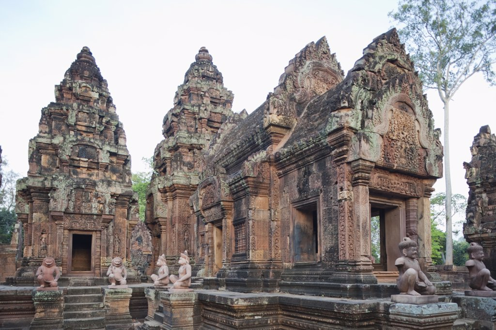 Statues at a temple, Banteay Srei, Angkor, Siem Reap, Cambodia : Stock Photo