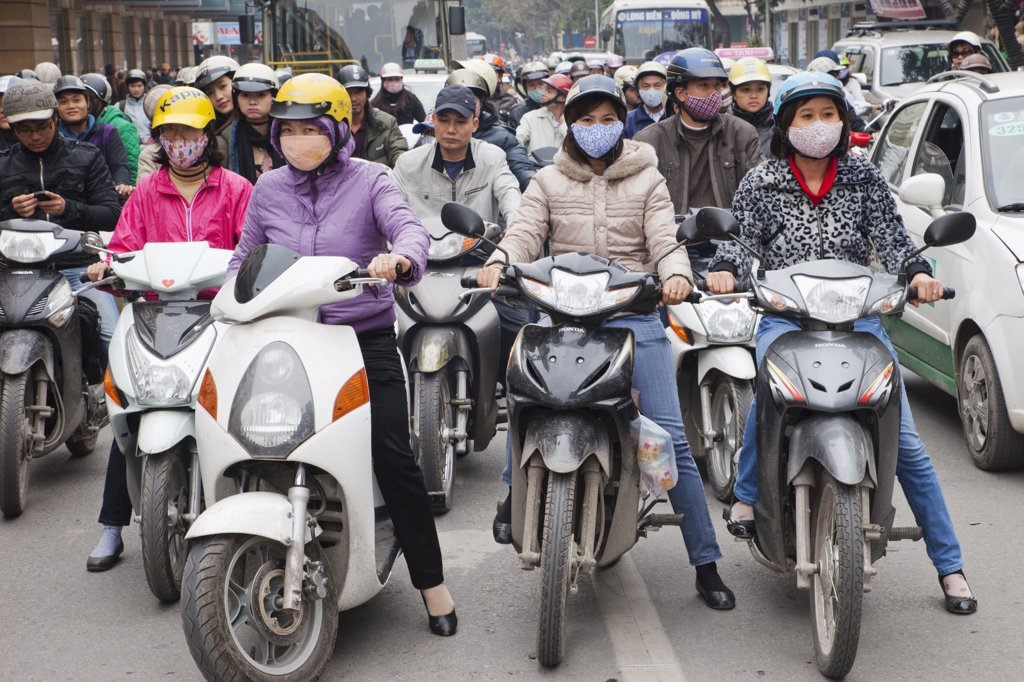 Traffic of motorbikes on the road, Hanoi, Vietnam : Stock Photo