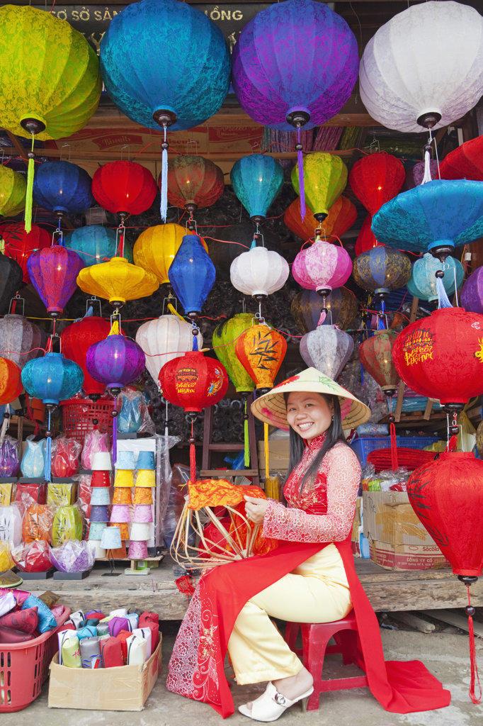 Stock Photo: 442-35530 Teenage girl making paper lanterns at a market stall, Hoi An, Vietnam