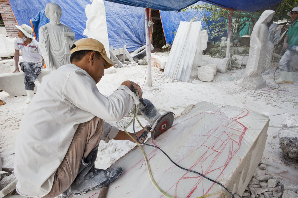 Stock Photo: 442-35543 Worker cutting a marble block, Marble Mountain, Danang, Vietnam