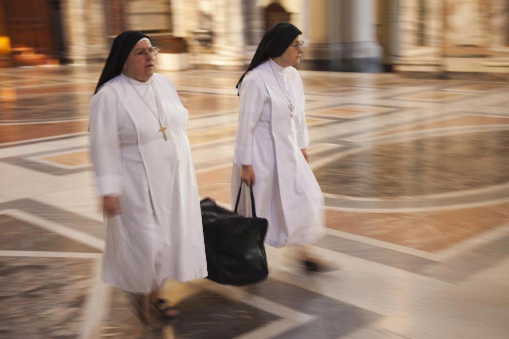 Italy, Rome, Two nuns walking in Basilica of St. John Lateran : Stock Photo