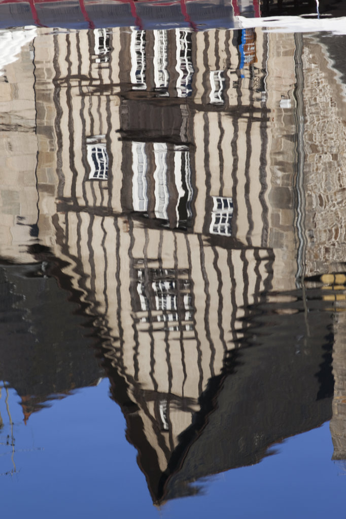 France, Brittany, Cotes-D'Armor, Dinan, Reflection of building in water : Stock Photo