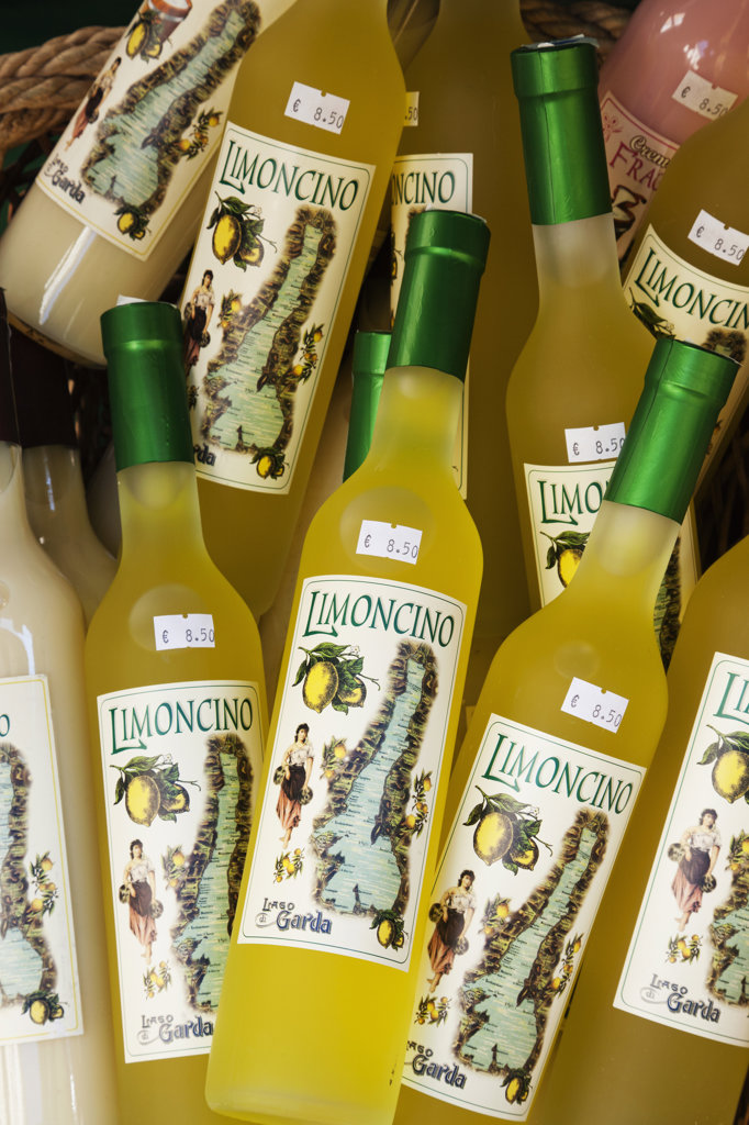 Liquor store display of Limoncino bottles, Riva del Garda, Lake Garda, Trento, Italy : Stock Photo