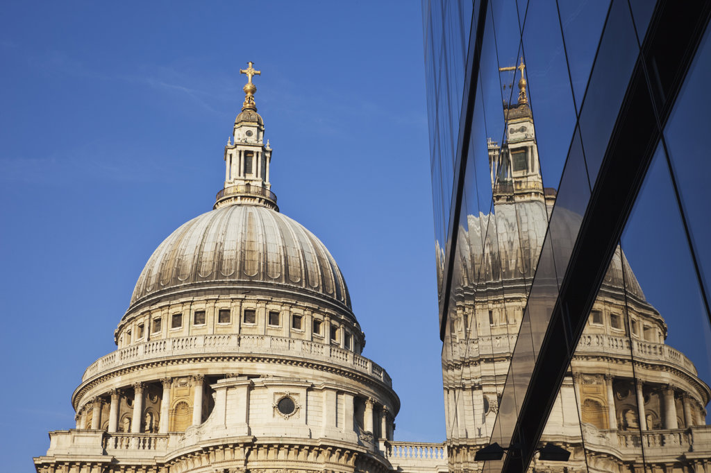 Reflection of St. Paul's Cathedral on glass building, City of London, London, England : Stock Photo