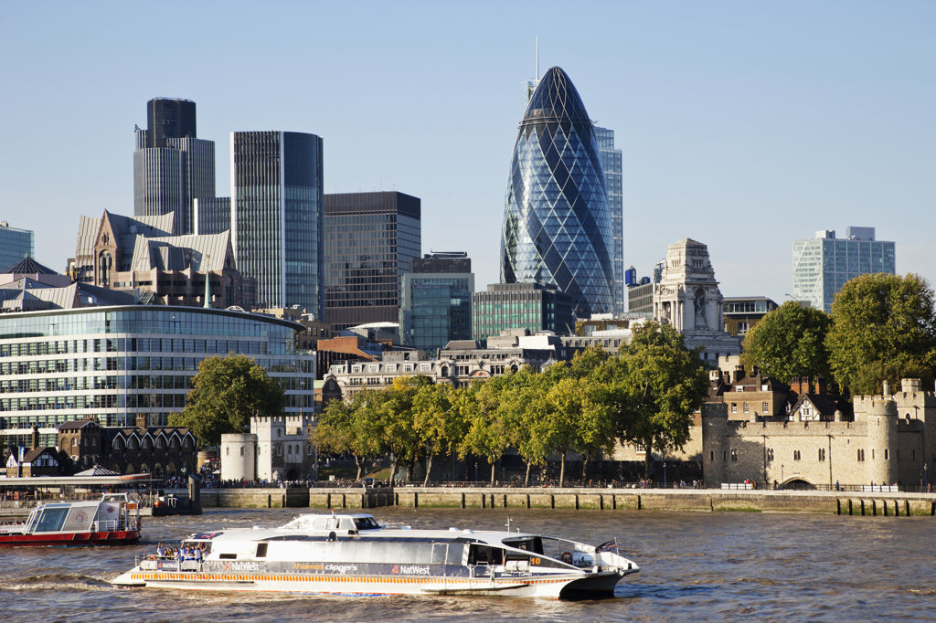 Tourboat in the river with office buildings in the background, City of London, London, England : Stock Photo