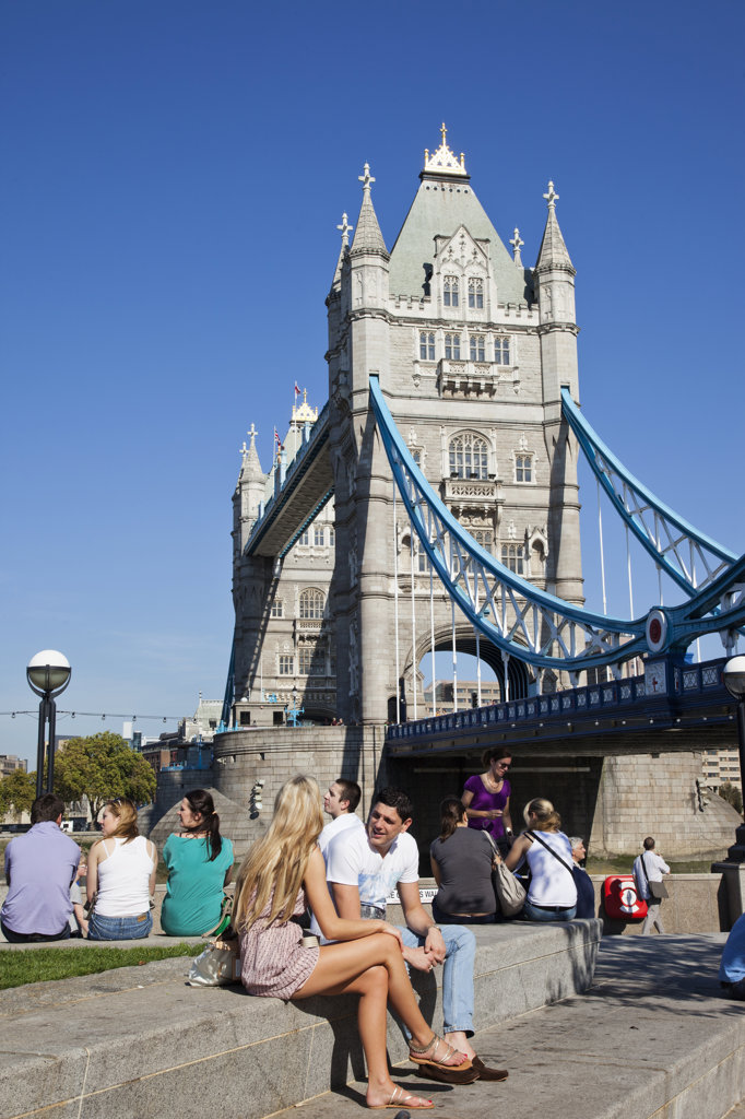 Stock Photo: 442-36377 Tourists sitting near a bridge, Tower Bridge, Thames River, London, England