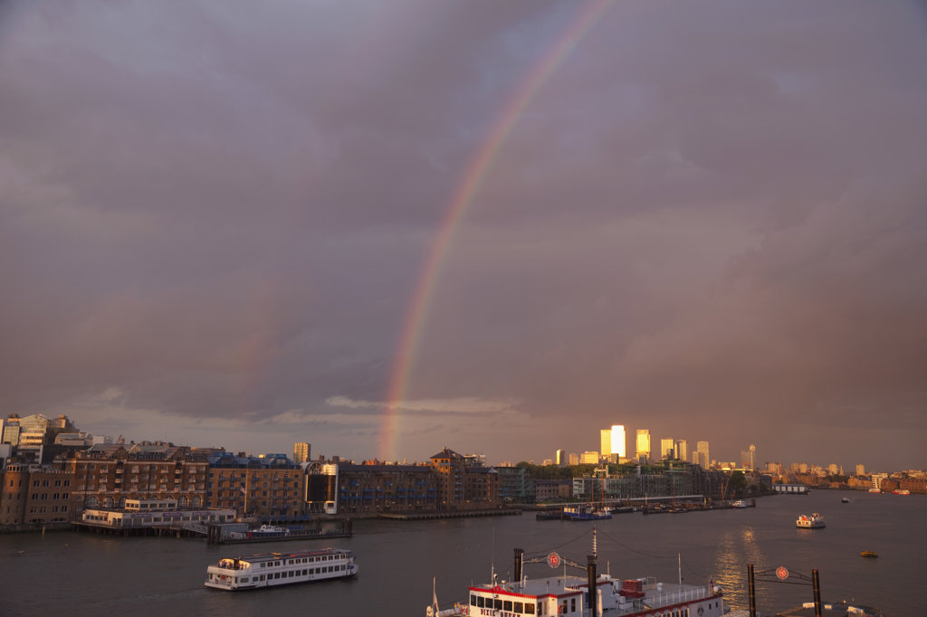 Rainbow over Docklands skyline and Thames River, Docklands, London, England : Stock Photo