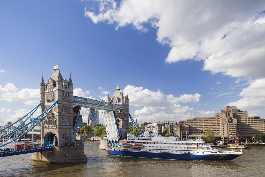 Cruise ship passing under a drawbridge, Tower Bridge, Thames River, London, England : Stock Photo