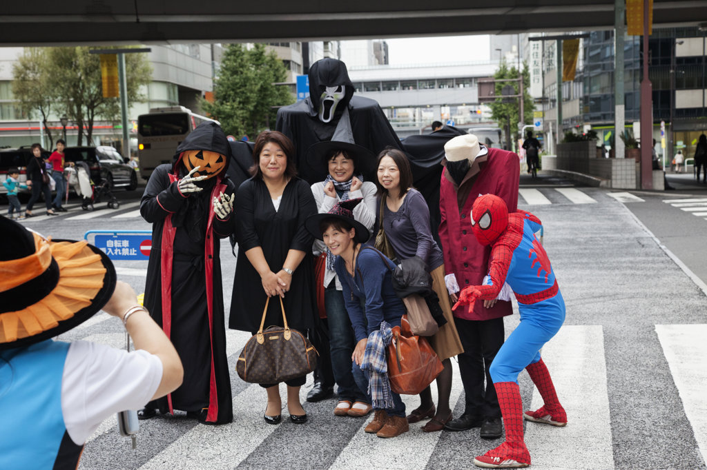 Shoppers posing with Halloween costumed characters, Ginza, Tokyo, Japan : Stock Photo