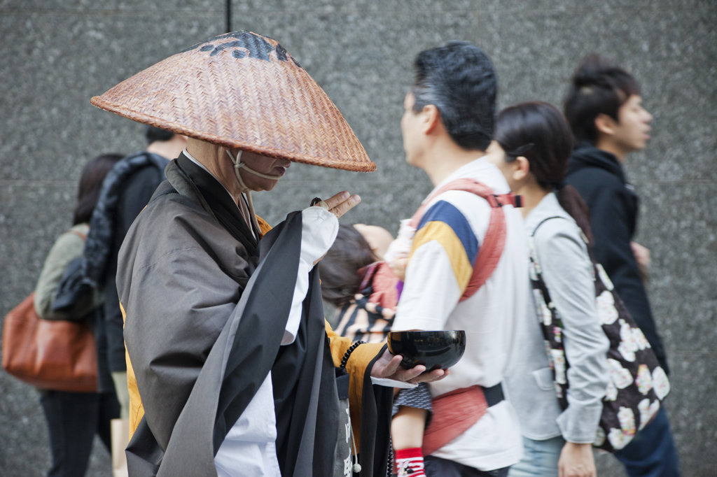 Monk collecting alms, Ginza, Tokyo, Japan : Stock Photo