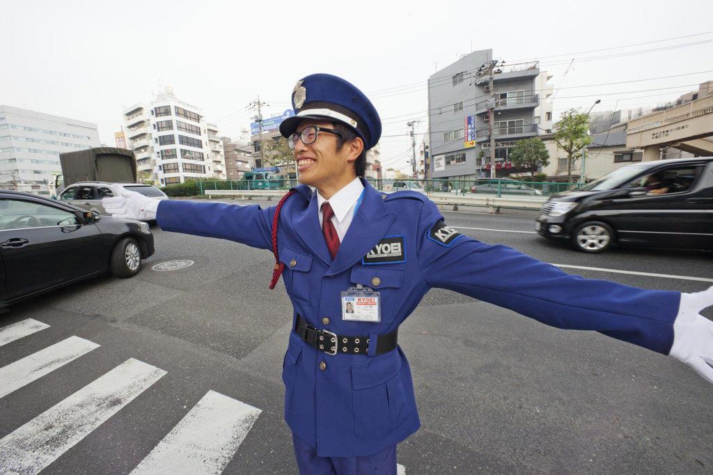 Stock Photo: 442-36585 Parking attendant controlling traffic, Tokyo, Japan