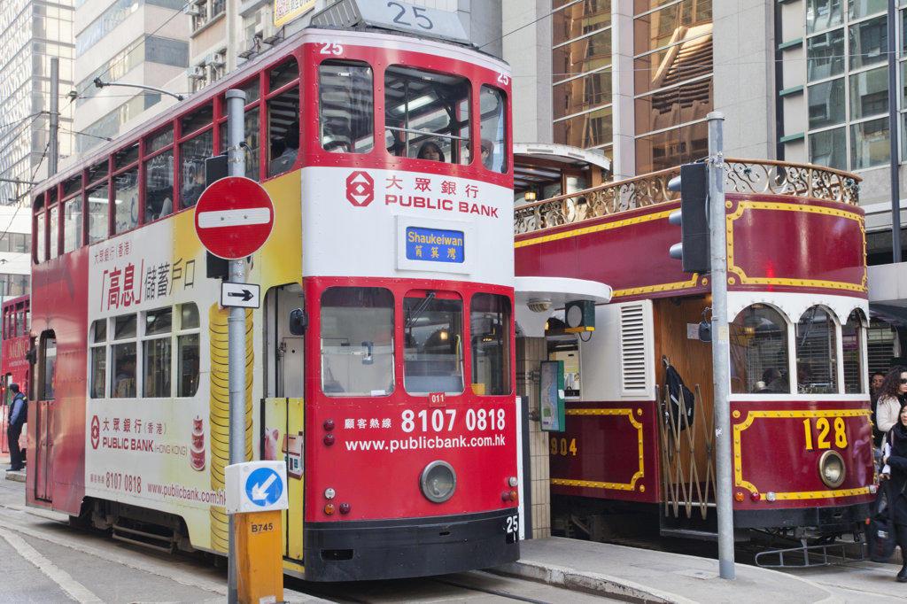 Trams on a street, Hong Kong, China : Stock Photo