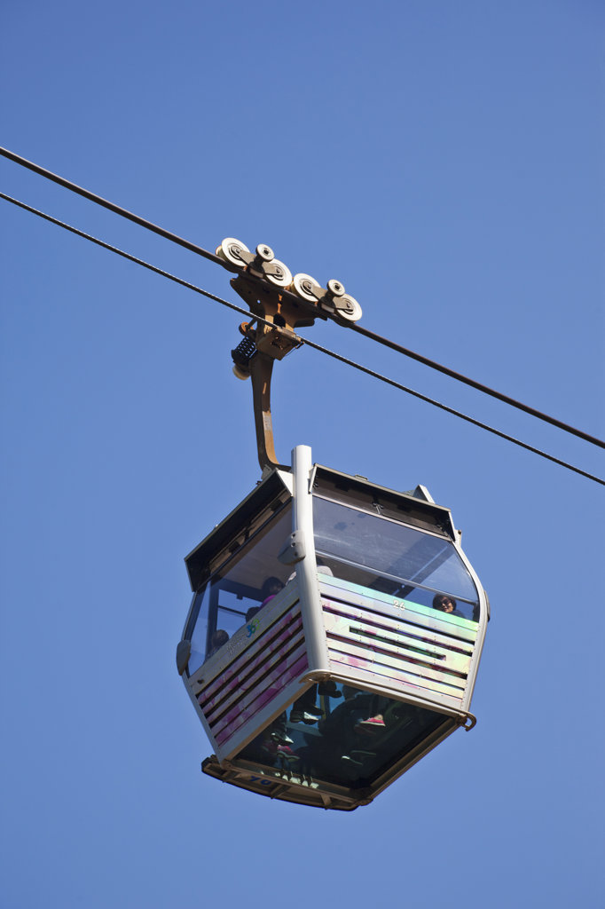 Stock Photo: 442-36718 Low angle view of an overhead cable car, Ngong Ping, Lantau, Hong Kong, China
