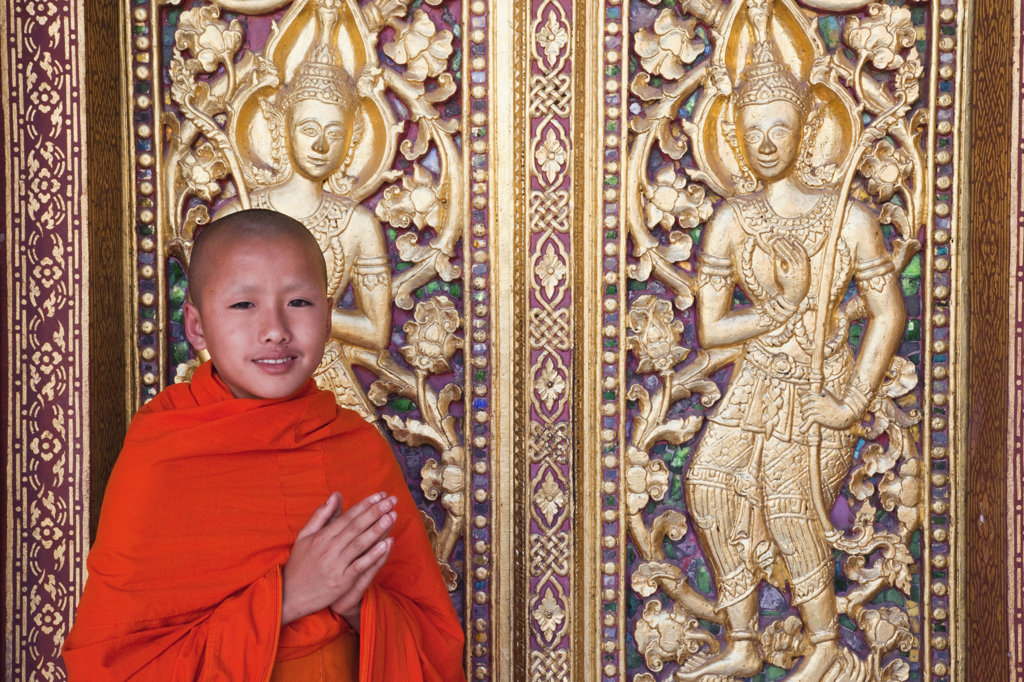 Stock Photo: 442-36944 Monk at main prayer hall doorway, Wat Sensoukarahm, Luang Phabang, Laos