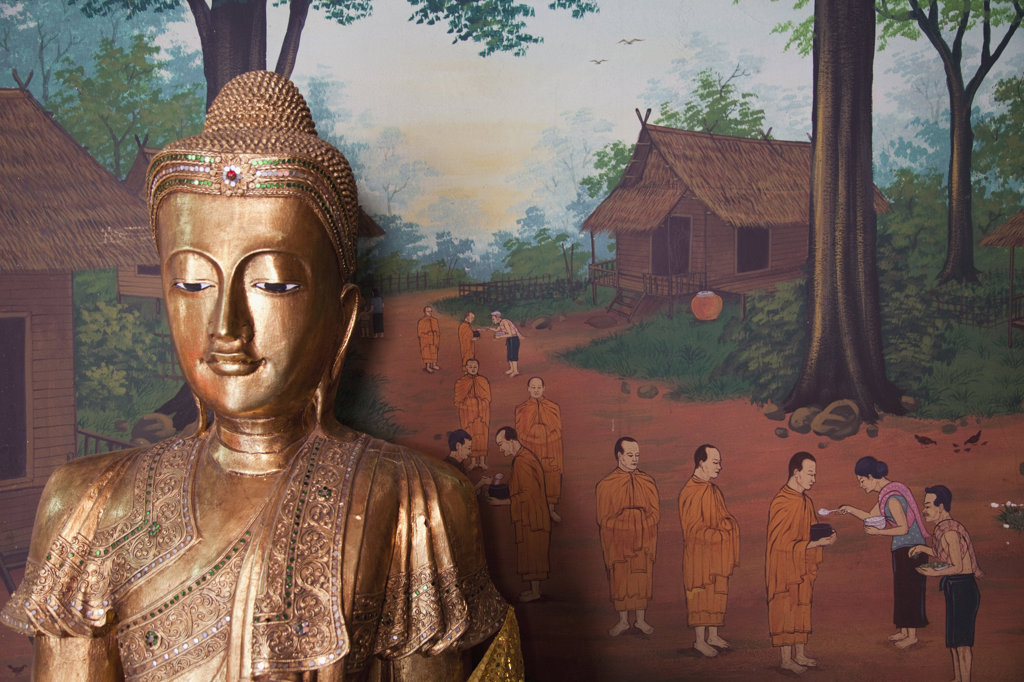 Stock Photo: 442-37042 Buddha statue and wall art depicting village life in Wat Chana Songkhram, Khaosan Road, Bangkok, Thailand