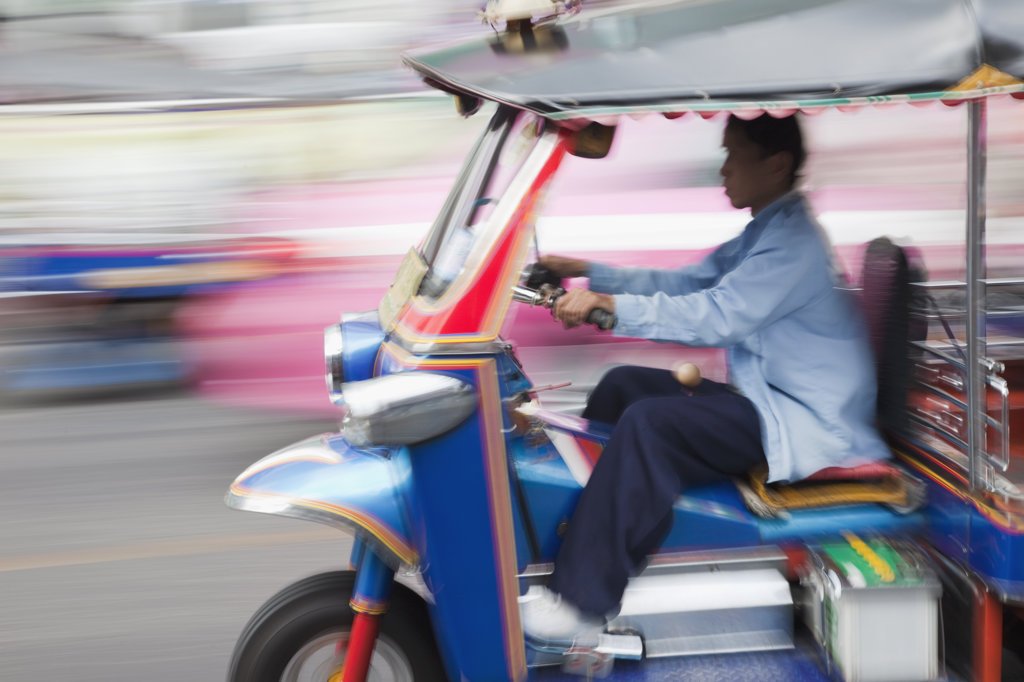Stock Photo: 442-37054 Man driving a tuk tuk, Bangkok, Thailand