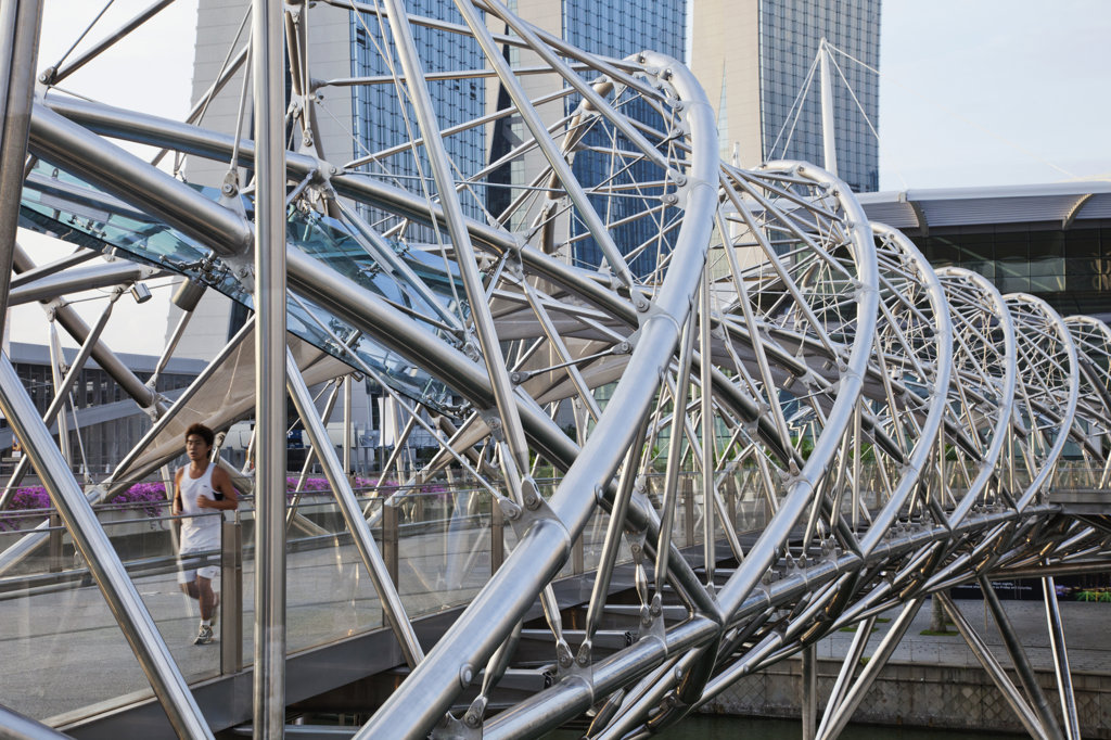 Man jogging on a footbridge, Helix Bridge, Singapore City, Singapore : Stock Photo