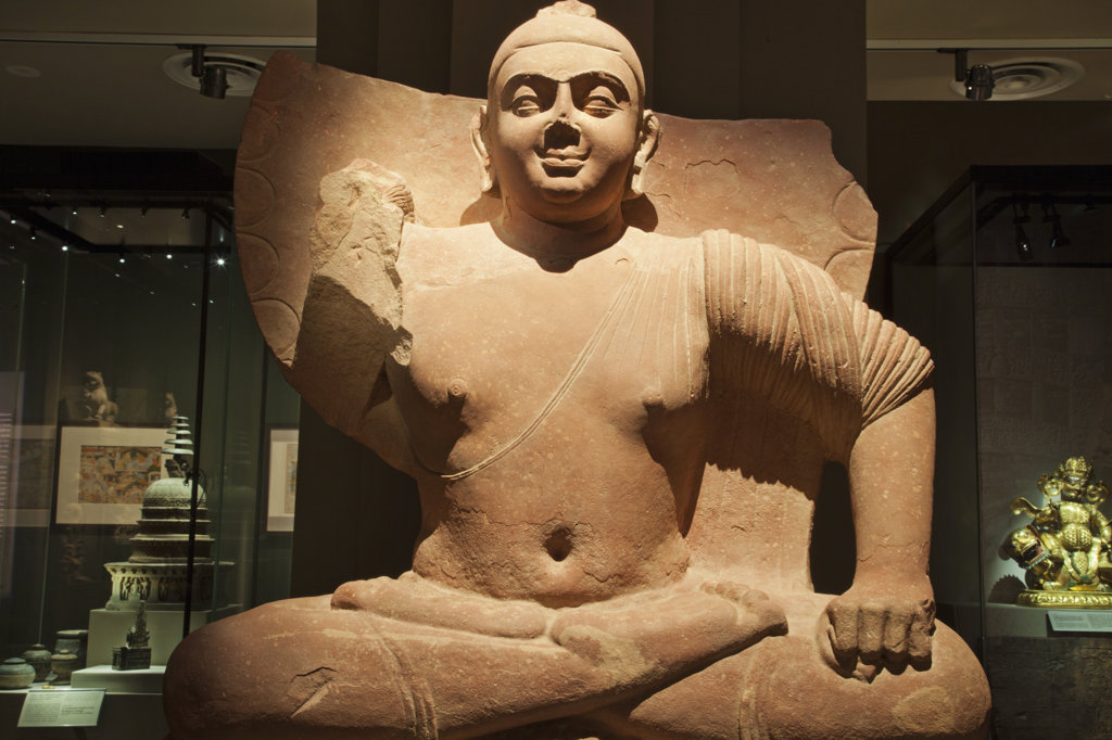 Sandstone seated Buddha Statue in a museum, Asian Civilisations Museum, Singapore : Stock Photo