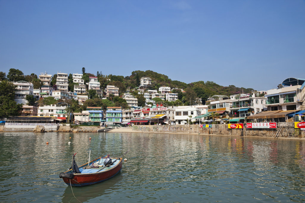 Stock Photo: 442-37347 Boat with a town at the waterfront, Yung Shue Wan, Lamma Island, Hong Kong, China