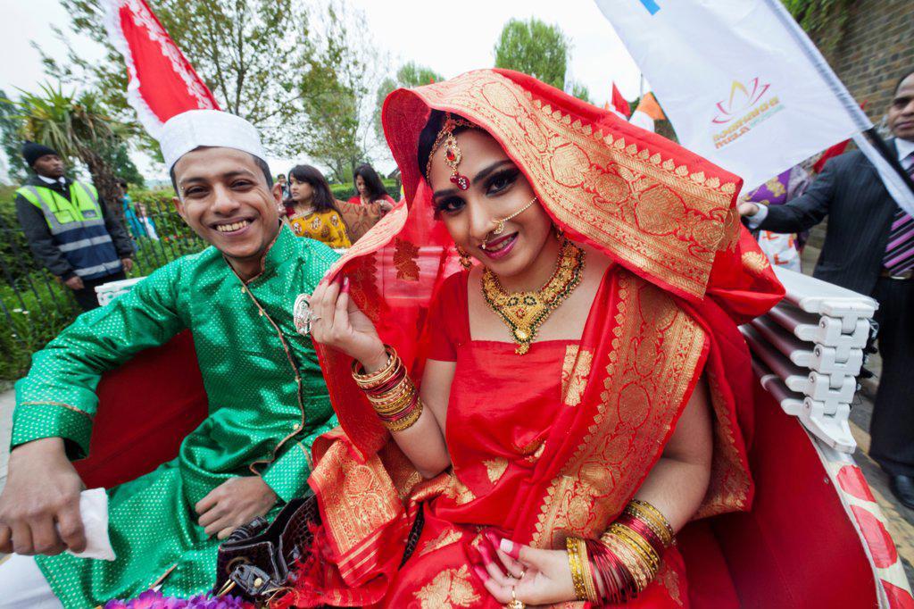 England, London, Banglatown, Bengali New Year Festival, Boishakhi Mela Parade, Couple in Traditional Wedding Costume : Stock Photo