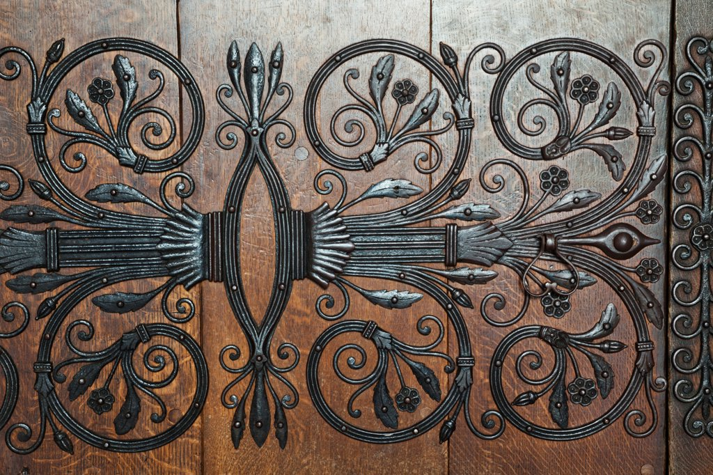 Stock Photo: 442-38064 England, Cambridgeshire, Ely, Ely Cathedral, Ornate Ironwork Pattern on Wooden Doorway