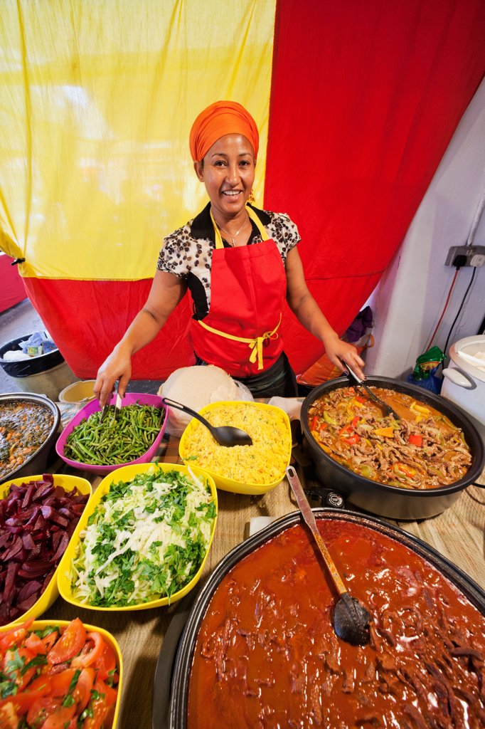 Stock Photo: 442-38210 UK, London, Whitechapel, Spitalfields Market, Seller at stall with Ethiopian Food
