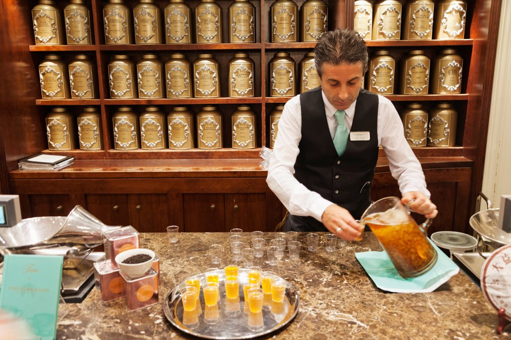 UK, London, Piccadilly, Bartender at tea store : Stock Photo