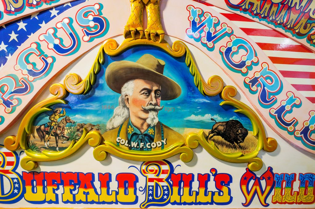 Stock Photo: 442-38533 UK, England, Somerset, Wookey Hole, Circus Museum, Detail Artwork of Circus Wagon depicting Buffalo Bill