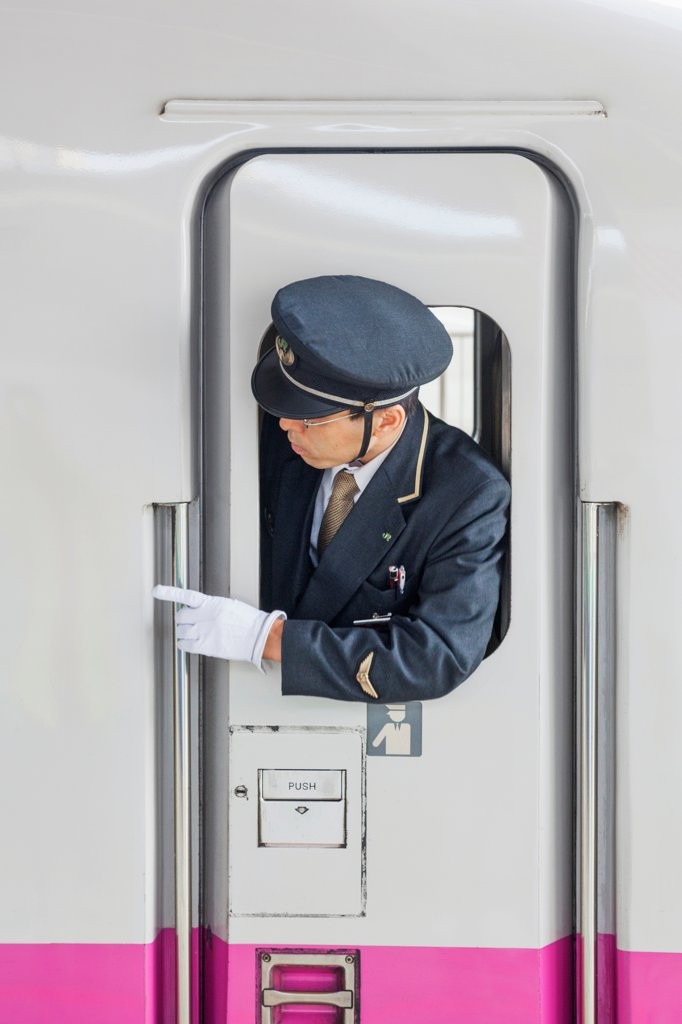 Stock Photo: 442-38656 Japan, Honshu, Kanto, Tokyo, Tokyo Station, Train Guard And Door Of Shinkansen Bullet Train