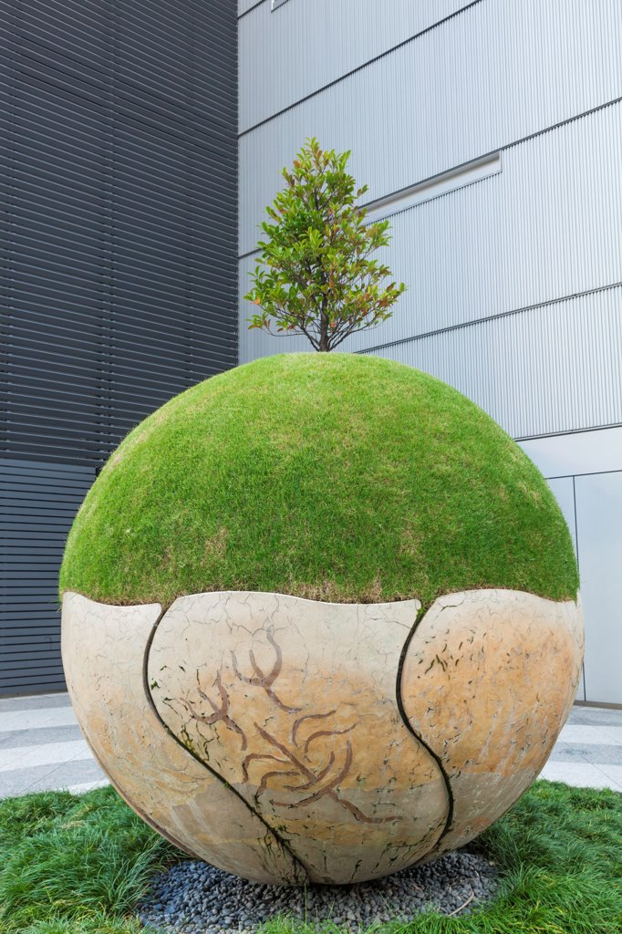 Stock Photo: 442-38839 Japan, Honshu, Aichi, Nagoya, Midlands Square, Sculpture Artwork depicting Greenery on Stone